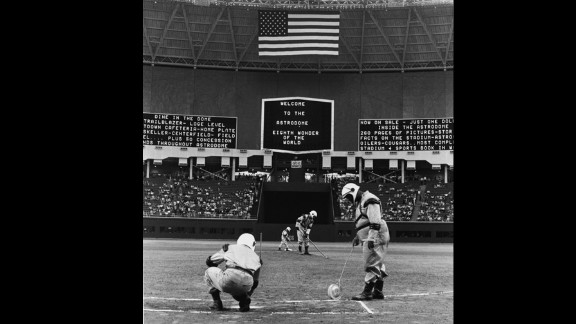 Groundskeepers wear spacesuit uniforms as they prepare for the Astrodome's first baseball game on April 12, 1965. The structure, with an inside height of 208 feet, has sat mostly empty since the Houston Astros left for a more modern stadium in 1999.