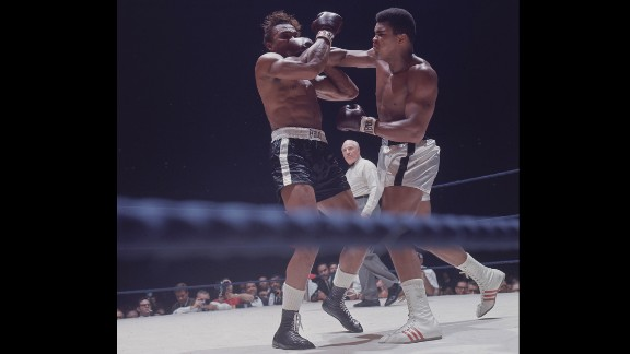 Legendary boxer Muhammad Ali, right, faces Cleveland Williams on November 14, 1966. Ali successfully defended his title as the world heavyweight champion.