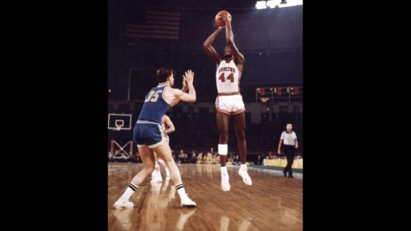"""Houston's Elvin Hayes goes for a jump shot against UCLA in what became known as """"The Game of the Century."""" The NCAA basketball game, played on January 20, 1968, was the first regular-season game broadcast in prime time on national television. It was also the first basketball game at the Astrodome."""