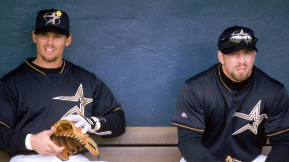 Craig Biggio, left, and Jeff Bagwell sit in the Houston Astros' dugout during the 1999 season. The Astros played their last game at the Astrodome on October 9, 1999, moving to the new Enron Field (now known as Minute Maid Park).