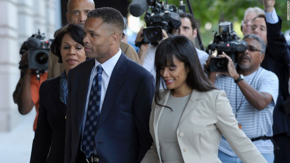 Former U.S. Rep. Jesse Jackson Jr. and his wife, Sandra, arrive at federal court in Washington for sentencing in August 2013. Jackson, a Democrat from Illinois, was sentenced to 30 months in prison for improper use of campaign funds, while his wife got 12 months for filing false tax returns.