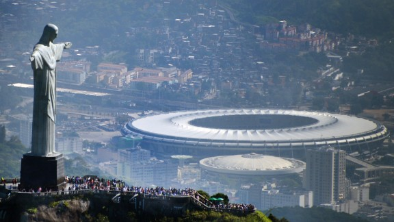 Aerial view of the Christ the Redeemer statue atop Corcovado Hill, overlooking the Maracana stadium in Rio de Janeiro, Brazil. The famous arena hosted the 2014 World Cup final in July, 2014.