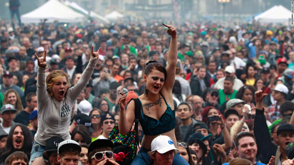 "Members of a crowd numbering tens of thousands smoke and listen to live music at the Denver 420 Rally on April 20, 2013. <a href=""http://www.cnn.com/2013/04/20/opinion/reiman-marijuana-day/index.html"">Annual festivals celebrating marijuana</a> are held around the world on April 20, a counterculture holiday."