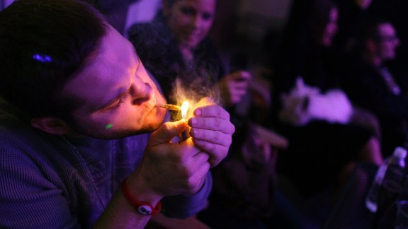 A man smokes a joint during the official opening night of Club 64, a marijuana social club in Denver, on New Year's Eve 2012. Voters in Colorado and Washington state passed referendums to legalize recreational marijuana on November 6, 2012.