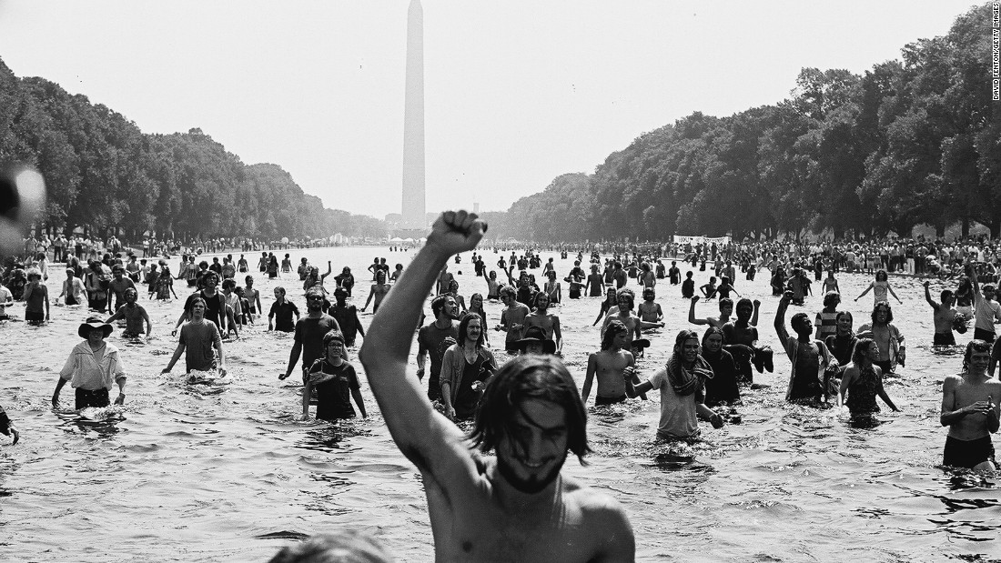 "Protesters wade in the Reflecting Pool at the National Mall in Washington during the ""Honor America Day Smoke-In"" thrown by marijuana activists in response to the official ""Honor America Day"" rally organized by President Nixon supporters at the Lincoln Memorial on July 4, 1970."