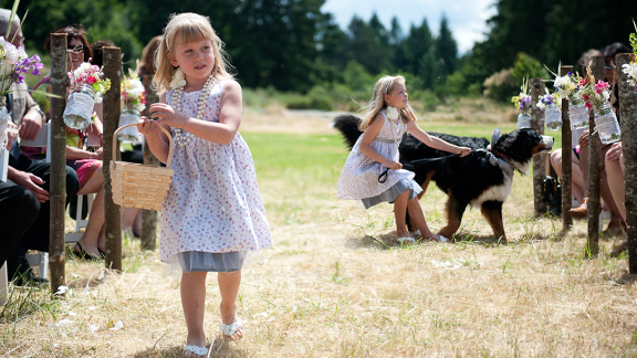 Flower girls are often a conduit for including pets in wedding ceremonies.