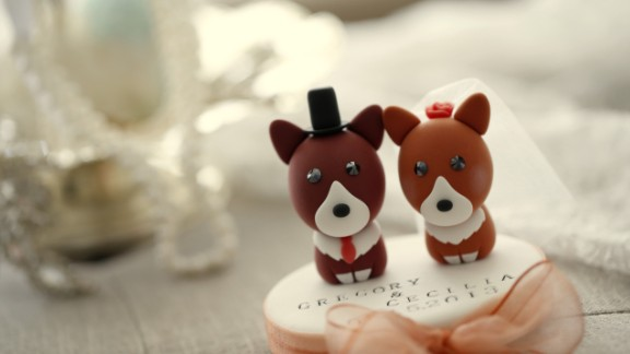 """Cake toppers, like these Welsh Corgis from""""KIKUIKE"""" help declare the happy couple's love for their pets."""