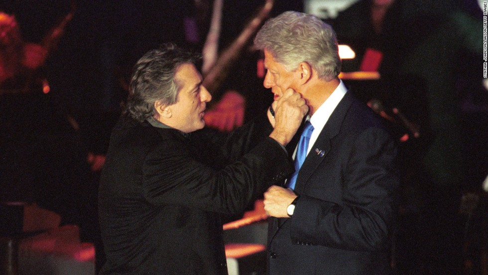 President Bill Clinton and De Niro goof around at a fundraiser on Hillary Clinton's birthday at New York's Roseland Ballroom in 2000.