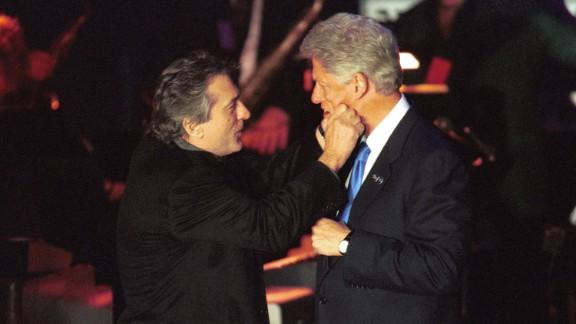 President Bill Clinton and De Niro goof around at a fundraiser on Hillary Clinton's birthday at New York's Roseland Ballroom in 2000.