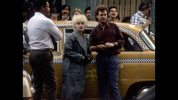 "Madonna and director James Foley work on the set of ""Who's That Girl"" on November 24, 1987, in Los Angeles."