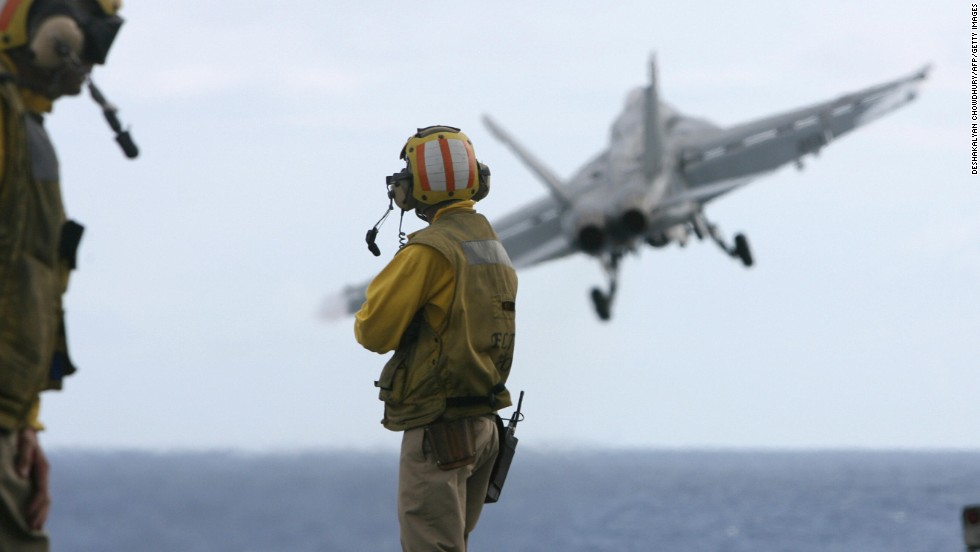A US F-18 fighter plane takes off from the deck of USS Kitty Hawk (CV63) aircraft carrier in the Bay of Bengal. Aircraft carriers have one of the highest attrition rates of any arm of the military. According to one study, between 1949 and 1988 the U.S. Navy and Marine Corps lost 12,000 aircraft and 8,500 air crew.