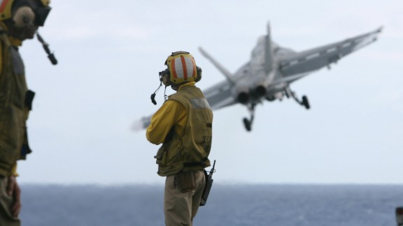 Jets take off from the deck of the USS Nimitz.