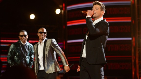 """Robin Thicke, right, had the song of the summer in 2013 with """"Blurred Lines."""" But the hit was dubbed """"rape-y"""" by some with its lyrics """"I know you want it"""" which critics said promoted sexual assault. The music video also came under fire for its use of nude women and spurred a parody video with scantly-clad men. Not to mention ... well, you know."""