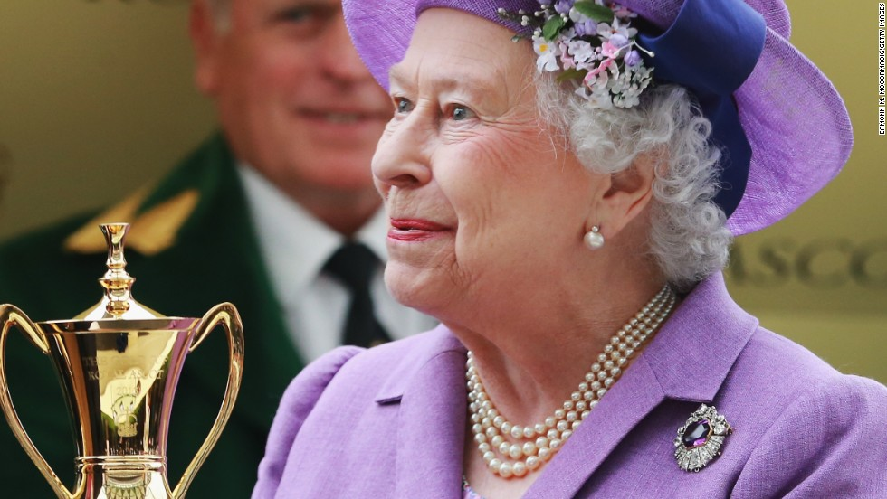 Queen Elizabeth II is all smiles after receiving the Gold Cup following her horse Estimate's triumph at Royal Ascot.