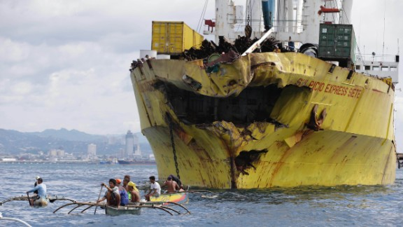 Volunteers search for victims near the damaged cargo ship Sulpicio Express Siete on Saturday, August 17, a day after it collided with a passenger ferry  in Talisay, in the Cebu province of the Philippines. The ferry, which sank, is thought to have been carrying about 700 passengers.