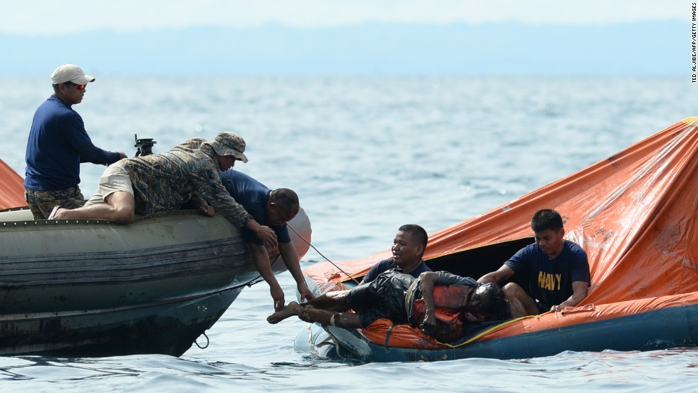 Philippine Navy personnel lift a victim from one of the floating life rafts during rescue operations on August 17. The two ships collided around 9 p.m. Friday.