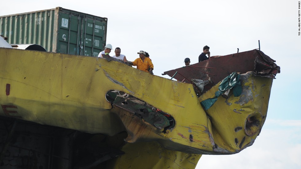 Crew members from the cargo ship inspect the damage to their ship on August 17.
