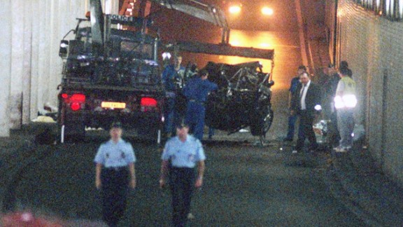 The wreckage is lifted onto a waiting truck.
