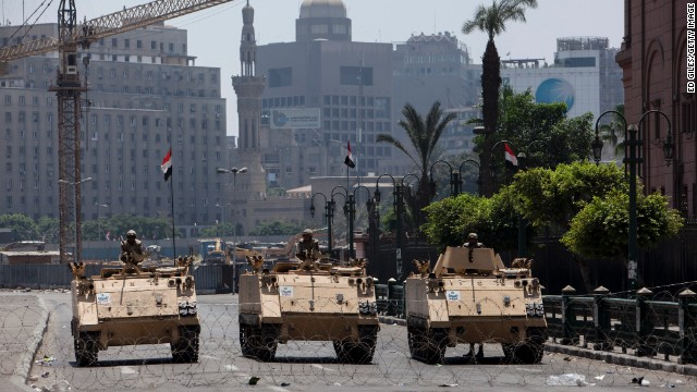Egyptian military armored vehicles stand guard at a checkpoint on the edge of Tahrir Square by the Egyptian Museum on August 16, 2013 in Cairo, Egypt.