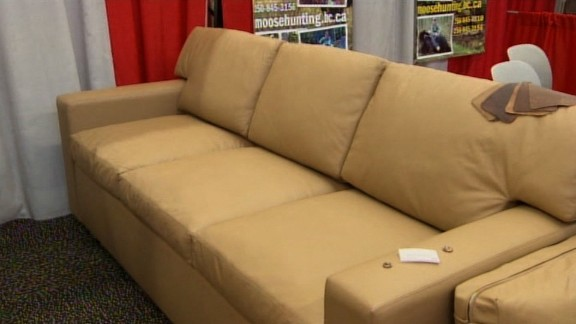 "Charles Alan, a furniture maker based in Fort Worth, Texas, showed off a new couch with a hidden gun safe inside and bulletproof cushions at a gun show. ""If there's a home invasion, you can take one of the cushions and hand it to one of your children or your spouse to protect them,"" Charles Alan's Brian Poitevent told CNN affiliate WFAA. ""We make them with arm straps, so you can hold the cushion with one hand and fire with the other hand."""