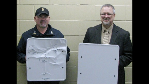 "Ahead of the fall semester, the University of Maryland-Eastern Shore announced that it is purchasing 200 bulletproof whiteboards from Hardwire LLC, a company based in Pocomoke City, Maryland. The shootings at Sandy Hook were a factor, said Juliette Bell, the university president. ""Anything that we can do that could potentially save a life, we are going to explore,"" she said. Pictured, Police Chief Phil Jones, left, and Rocori School District Superintendent Scott Staska of Cold Spring, Minnesota, where schools acquired the kevlar whiteboards."