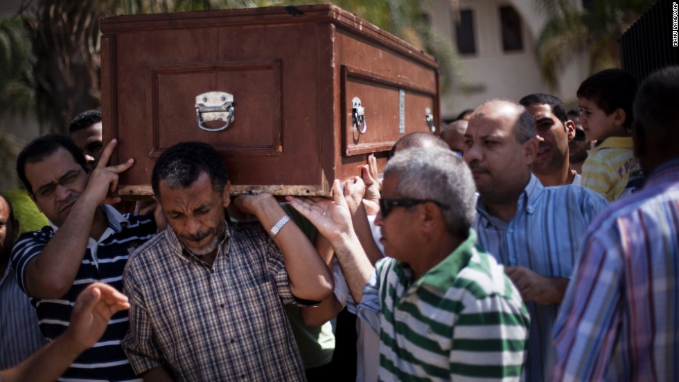 Friends and relatives of Ammar Badie, 38, killed during clashes in Ramses Square, carry his coffin during his funeral in Al-Hamed mosque in Cairo on August 18, 2013. Ammar Badie was the son of the Muslim Brotherhood's spiritual leader, Mohammed Badie.