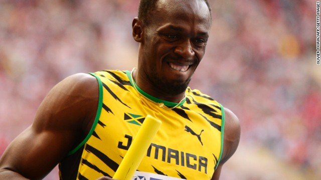Usain Bolt crosses the line first for Jamaica in the men's 4x100m relay to claim his third gold of the world championships.