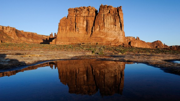 """<a href=""""http://www.cnn.com/2013/08/22/travel/arches-summer-park/index.html"""">Arches National Park</a> is one of 401 National Park Service sites to close to visitors during the government shutdown."""