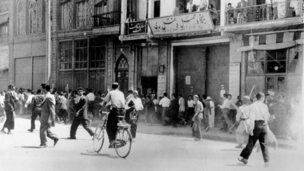 Rioters armed with staves are chased by soldiers in Tehran.