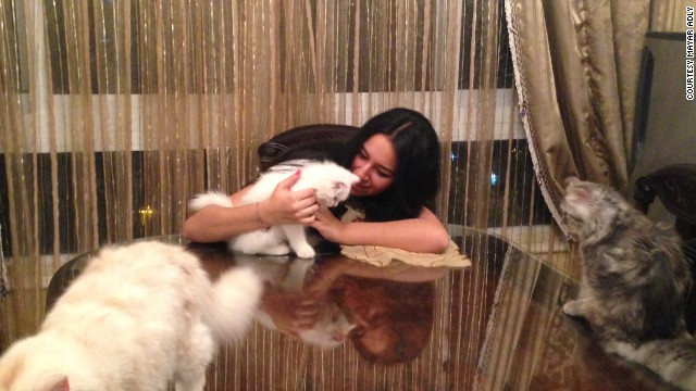 Unrest has prompted Mayar Adly, 20, to spend most days in her Cairo apartment  with family members and their cats.