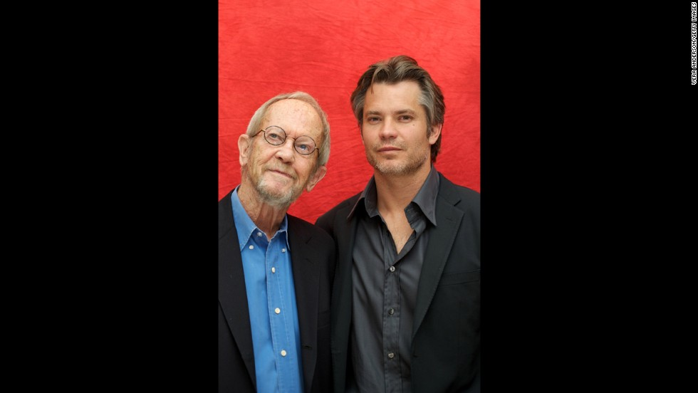 "Leonard and Timothy Olyphant pose for photos at a press conference in June 2010 in Beverly Hills. Olyphant stars in the TV series ""Justified,"" which is based on Leonard's novels."