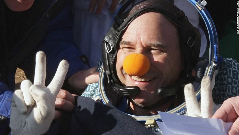 CEO of Cirque du Soleil Guy Laliberte flashes a victory sign shortly after landing with members of the 20th main mission to the International Space Station on October 11, 2009.