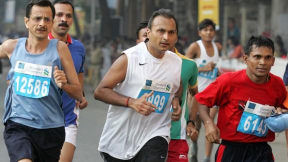Reliance Communications Chairman Anil Ambani, center, makes tracks during the Mumbai Marathon in Mumbai, India, in 2007.