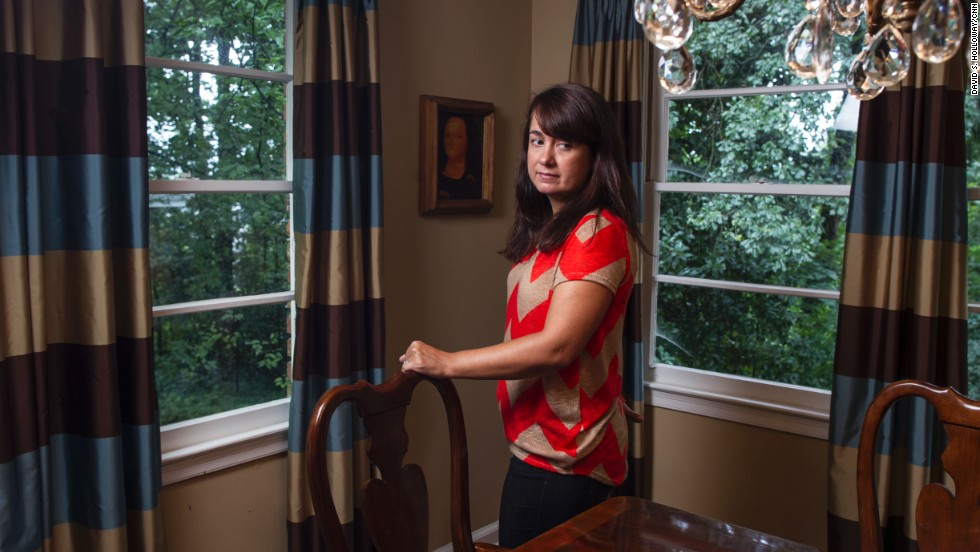 Keely Walker Muse stands in her home in Atlanta. She blames Mexican drug  lord Rafael