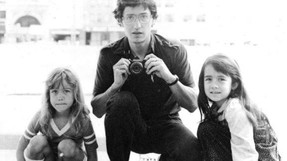 John Walker poses for a portrait with his daughters Lannie, left, and Keely in Minneapolis.