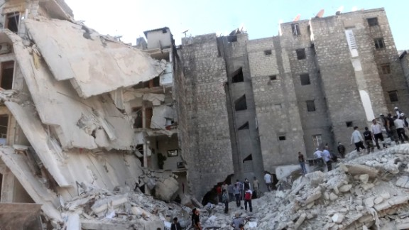 People search the rubble of a bombed building in Aleppo, Syria, on Friday, August 16.