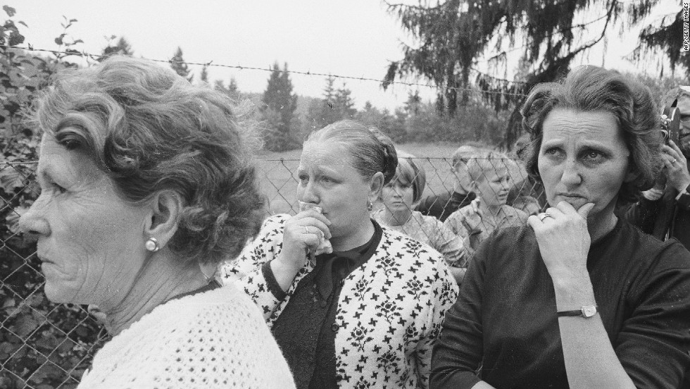 Immediately after the invasion, an estimated 70,000 people fled the country. Eventually, over 300,000 people emigrated. Friends and family of some of the refugees are pictured here at the border between Czechoslovakia and Germany.