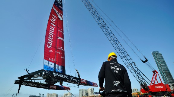 Team NZ's AC-72 racing yacht is lowered into San Francisco Bay for an 2013 America's Cup training session.