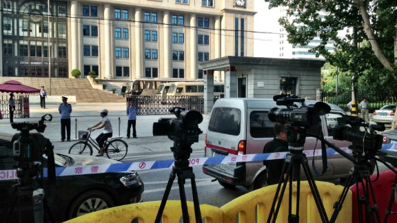"Tight security is in place around the courthouse in Jinan, China, on Wednesday, August 21 -- the day before China's so-called ""trial of the century."""