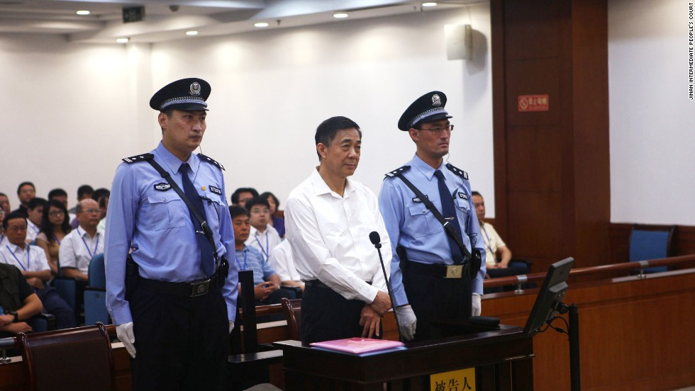 Fallen political star Bo Xilai stands for trial at the Jinan Intermediate People's Court on Thursday, August 22.