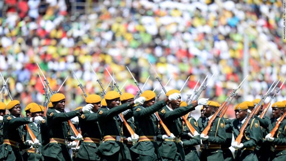 "AUGUST 22 - HARARE, ZIMBABWE: Zimbabwean Guards of Honor march during <a href=""http://cnn.com/2013/08/22/world/africa/zimbabwe-swearing-in/index.html"">Robert Mugabe's swearing-in ceremony</a> at the 60,000-seater stadium in Harare. Supporters were clad in clothes emblazoned with the image of the <a href=""http://cnn.com/2013/08/02/world/africa/mugabe-profile/index.html"">veteran leader</a>, who has ruled the nation since 1980. The packed venue is a show of force after elections many say were rigged."