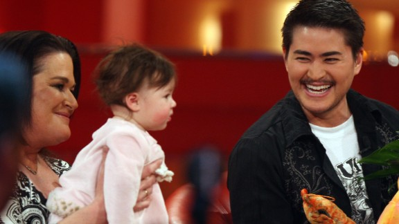 """Thomas Beatie, right, made headlines as """"the pregnant man"""" when he gave birth to his daughter, Susan, in 2008. Beatie wrote a book about his experience called """"Labor of Love: The Story of One Man's Extraordinary Pregnancy."""""""