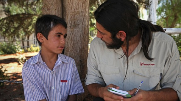 Mustafa meets with a Mercy Corps team member to talk about his experiences in Syria. Mercy Corps says trained psychosocial workers act as mentors by encouraging healthy self-expression and openness.