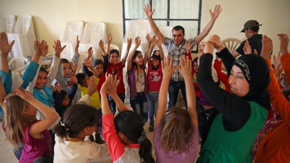 Syrian refugee children participate in co-operative games and collaborative storytelling to learn to move past painful experiences to trust one another and support their own health and well-being.