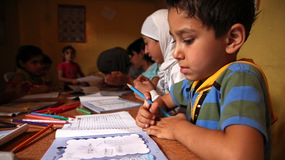 """Ibrahim, 6, attends Mercy Corps' """"Comfort for Kids"""". The program is designed to help kids process trauma with an interactive workbook that helps them tell their story of the conflict in a safe environment."""