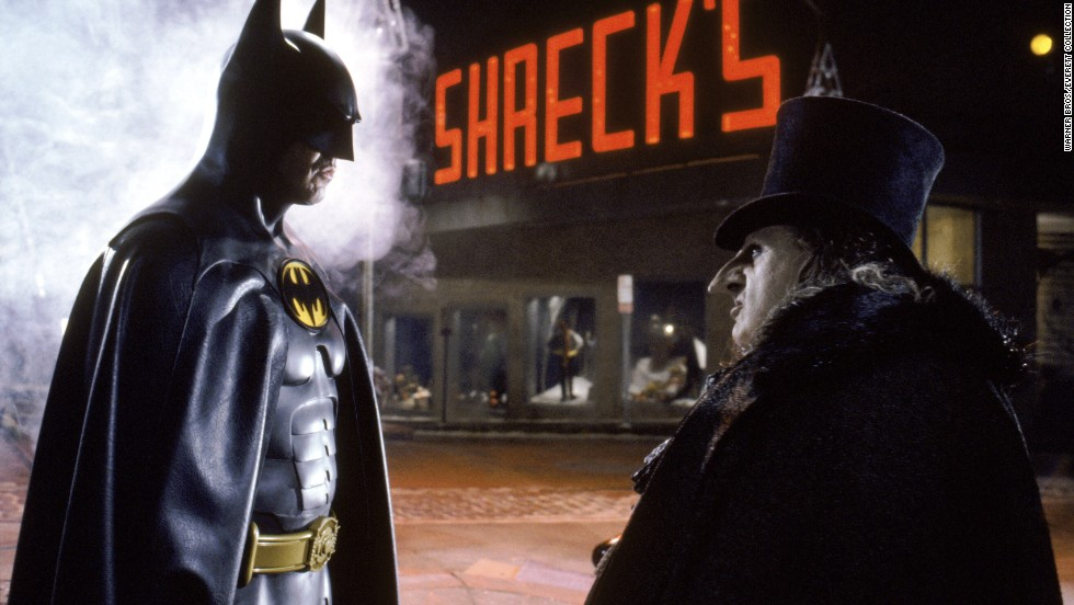 "Twenty years after Adam West's Batman came Michael Keaton in Tim Burton's 1989 ""Batman."" He played more of a dark, explosive Batman, the opposite of West's goofy type. Keaton's performance in the movie received favorable reviews, and he became the first actor to reprise the role in 1992's ""Batman Returns"" with Danny DeVito as the Penguin."