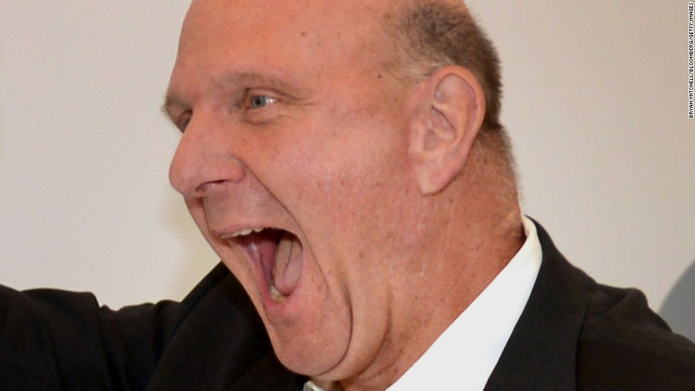 Ballmer speaks, or perhaps yells excitedly, during the 2013 opening of a Microsoft store in Troy, Michigan.