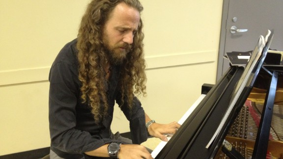 Nacho Arimany improvises on piano at the conference. He