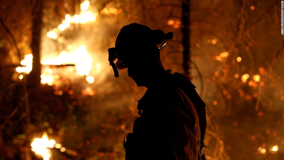 A firefighter from Cosumnes Fire Department monitors a back fire while battling the Rim Fire on August 22, in Groveland, California.