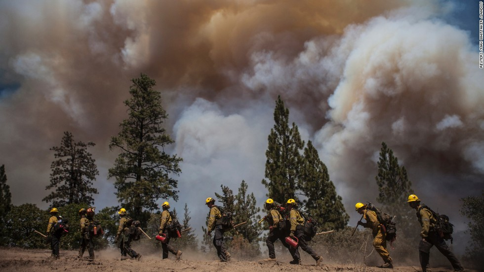 Los Angeles County firefighters hike in on a fire line on the Rim Fire near Groveland, California, on August 22.